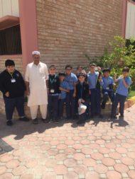 The Gardening Club with the school's gardener Jaleel
